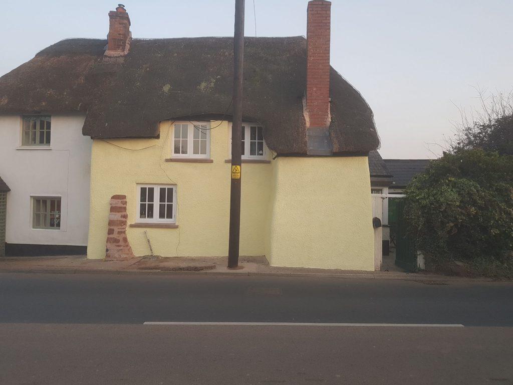 External lime rendering, cob cottage in Mid Devon