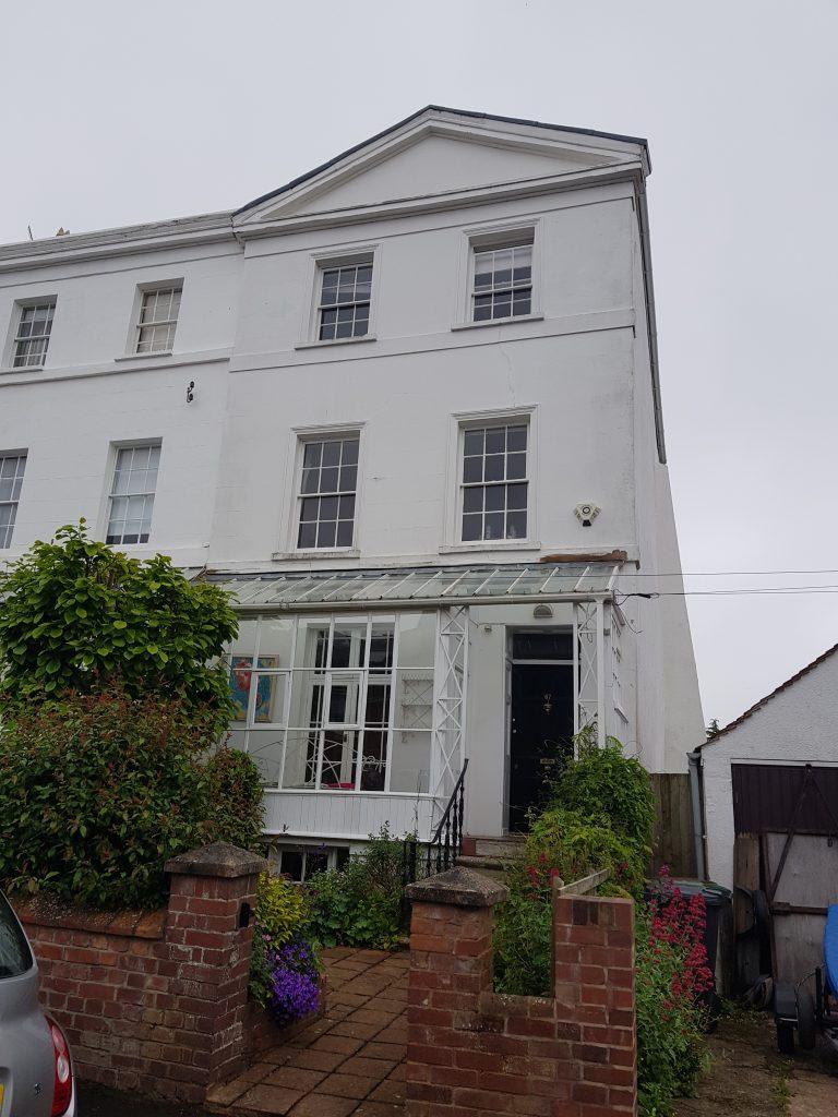 Exeter townhouse - external decorative plaster project - Earthouse Building Conservation Ltd